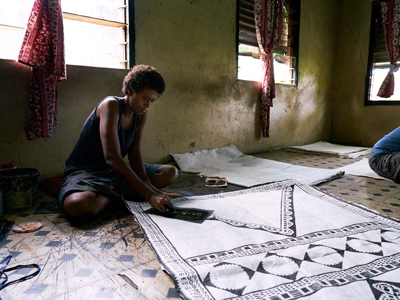 Tara decorates the dried tapa cloth with stencil designs and dye obtained from mangroves, charcoal and seeds. Access to safer drinking water is vital for livelihoods and income generating activities.